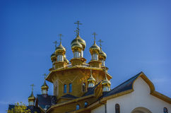 The golden dome on the wooden russian church. Of the Holy Martyrs Faith, Hope and Charity and their mother Sophia in Belgorod, Russia. Close-up photo royalty free stock photo