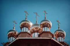 The golden dome on the wooden russian church. Of the Holy Martyrs Faith, Hope and Charity and their mother Sophia in Belgorod, Russia. Close-up photo stock photo