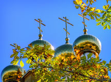 The golden dome on the  wooden russian church Royalty Free Stock Photos