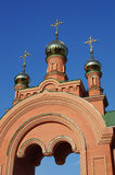 Golden domed entrance to monastery territory Stock Photo