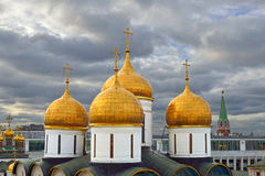 Golden domes of Assumption Cathedral of Moscow Kremlin Stock Photos