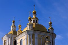 Golden domes of the cathedral against the blue sky. Large, golden domes of the central cathedral of the city against the blue sky royalty free stock photo