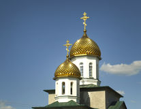 Golden domes. The golden domes of the Christian church in the city of Astrakhan. Russia Royalty Free Stock Images