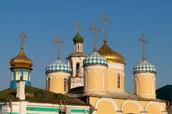 Golden domes of the Christian church. Is located in one of the cities of Russia against the deep blue sky Stock Photo