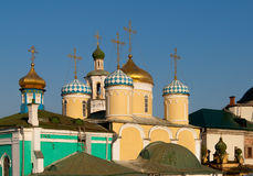 Golden domes of the christian church. Golden domes of the Christian church is located in one of the cities of Russia against the deep blue sky Stock Image
