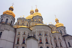 Golden domes of Christian churches tend toward the. Sky. The temple and the sky combining color - symbolic image. Troitskaya, Kyiv-Pechersk Lavra Royalty Free Stock Photo