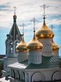 Golden domes. Of the church against the sky stock photo