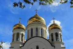 Golden domes church. Golden domes with crosses of the white Orthodox church on the background of bright blue sky in summer day, Moscow, Russia stock images