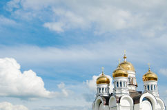 Golden domes. Church with golden domes under a blue sky royalty free stock image