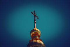 Golden domes and crosses against the blue sky. Stock Photo