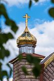 Golden domes and crosses of the orthodox church on a blue sky background stock photography