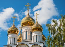Golden domes. And crosses of an orthodox temple against the sky royalty free stock images