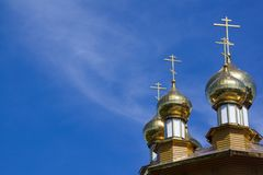 Golden domes and crosses of Russian orthodox church on blue sky background. Belgorod, Russia stock images