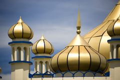 Golden domes on mosque Stock Photo