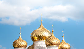 Golden Domes Of Russian Church Against Blue Sky. Stock Photo