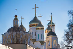 Golden domes of the Orthodox church. Golden domes of the Orthodox church against the blue morning sky stock photos