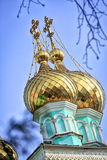 Golden domes. Golden domes of the Orthodox church in Almaty royalty free stock photos