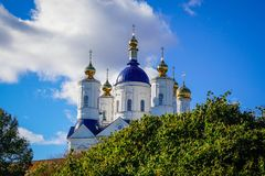 Golden domes of the Orthodox church. In the midst of autumn foliage stock photos