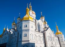 Golden domes of Pochaiv Lavra. Golden domes of Lavra Pochaiv on a clear day royalty free stock photo