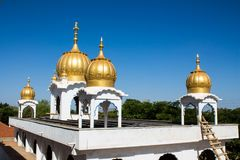 Golden domes on the roof of Sikh temple. Sikh temple golden domes on the roof in Makindu, Kenya. Sikhism religion. Guru Singh royalty free stock images