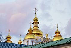 Golden domes, russia, Christian temple, ukraine, historical, Eas. Golden domes of the Orthodox Christian temple against the blue sky with clouds. Easter, Spring royalty free stock photos