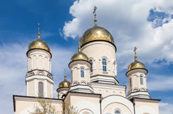 Golden domes of Russian orthodox church with cross Royalty Free Stock Photo