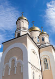 Golden domes of Russian orthodox church with cross Stock Photos