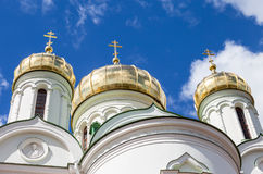 Golden domes of Russian orthodox church with cross Stock Images