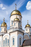Golden domes of Russian orthodox church with cross Royalty Free Stock Image