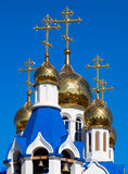 Golden domes of Russian orthodox church with cross Royalty Free Stock Images