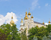 Golden domes of Saint-Pokrova monastery. View of golden domes and crosses of Saint-Pokrova monastery in Kharkov Royalty Free Stock Images