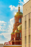 Golden domes. Sunny glitter of golden domes of the Cathedral displayed due to the corner of the building. Stroitel town stock images