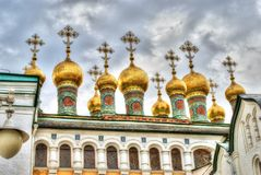 Golden Domes of Terem Churches. Verkhospassky Cathedral in Moscow Kremlin stock photography