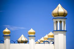 Golden domes on white mosque Stock Photo
