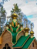 Golden domes on a wooden church. In Ekaterinburg stock photography