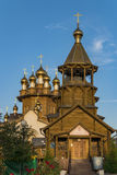 Golden domes of the wooden Russian temple Royalty Free Stock Image
