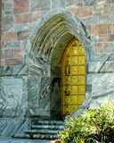 A Golden Door. A beautiful, arched golden door set in a building of pink and gray marble.  Bok Tower, Florida Stock Image