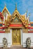 Golden door dragon statues Wat Pho temple bangkok thailand. Golden door and dragon statues at Wat Pho temple bangkok thailand stock images