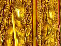 Golden door guards temple Stock Photos