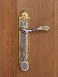Golden Door Handle. And a key in the key hole stock image