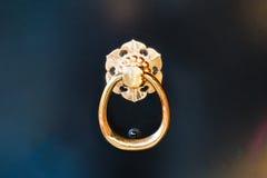 Golden door knocker. Royalty Free Stock Photography