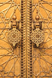 Golden door at palace in fez Stock Images