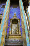 Golden door with Thai style art in grand palace Stock Images