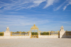 Golden door of Versailles Chateau. Golden door and statues at entrance of Versailles Chateau. France series Royalty Free Stock Images