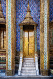 Golden doors of famous temple in Thailand Stock Images