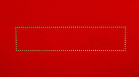 Golden dots frame on red background Stock Images