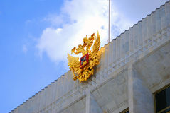 Golden double eagle, official state symbol of Russ. Ia.Decoration on the facade of the Big Kremlin concert hall in Moscow Kremlin royalty free stock images