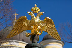 Golden double-headed eagle on a background of blue sky Stock Photo
