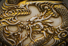 Golden dragon. Dragon motif on an old Chinese pottery. Chinese New Year Stock Photography