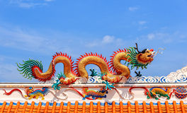 Golden Dragon against Blue Sky Background, Close-up Stock Photography